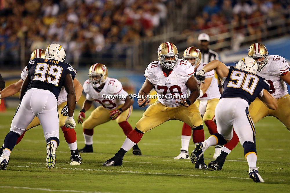 San Francisco 49ers guard Joe Looney (78) blocks during the NFL week 4 preseason football game against the San Diego Chargers on Thursday, Aug. 29, 2013 in San Diego. The 49ers won the game 41-6. ©Paul Anthony Spinelli