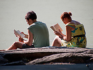 A quiet Sunday afternoon read at Turtle Pond, Central Park, New York City.