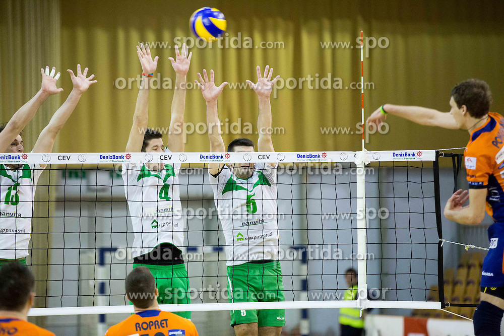 Aljosa Bogozalec, Uros Pavlovic and Dejan Pelemis of Panvita vs Jan Pokersnik of ACH  during volleyball game between OK ACH Volley and OK Panvita Pomgrad in 1st final match of Slovenian National Championship 2013/14, on April 6, 2014 in Arena Tivoli, Ljubljana, Slovenia. Photo by Vid Ponikvar / Sportida