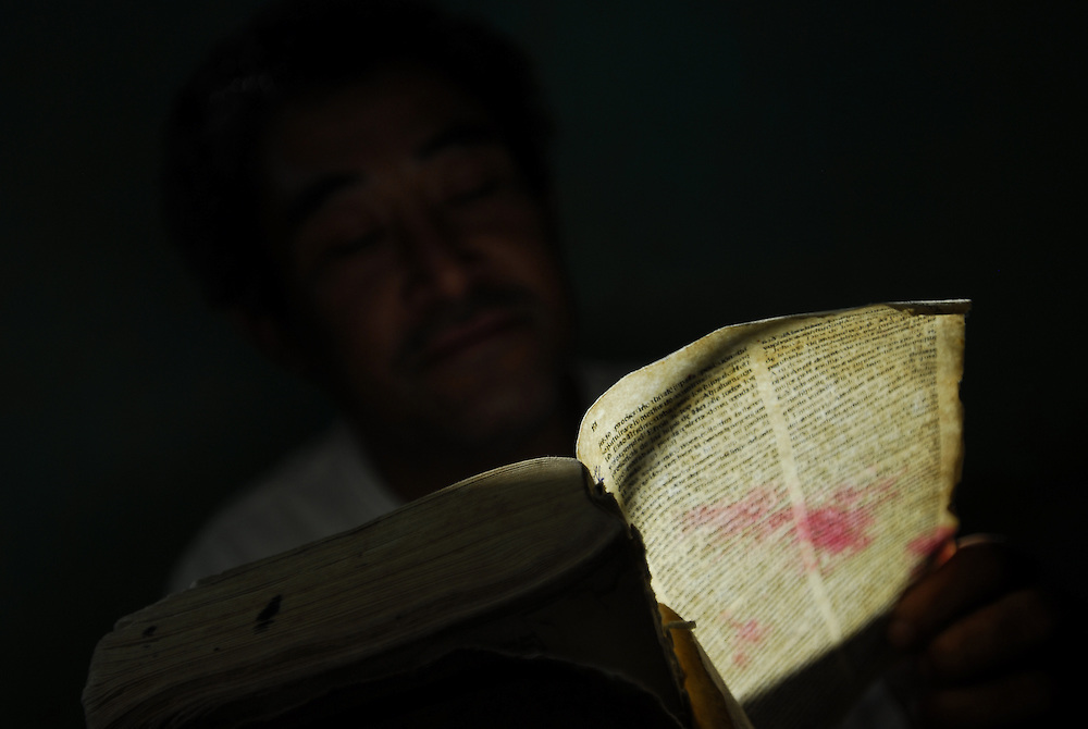 "Adolpho Fong, 46, reads the Bible at Casa Hogar, a rehabilitation home for alcohol and drug addicts, outside of Antigua, Guatemala. Fong, a former teacher, lost his family to his addiction to alcohol and cocaine. ""After being high for 2 months straight I decided to get sober,"" he says. He has been at Casa Hogar for two weeks now...Time weighs heavily on the residents and they try to fill every waking hour with something to keep themselves occupied. ""It's so boring being sober,"" says Fong...Casa Hogar currently houses 44 men (with a maximum of 60.) Jorge Rosales, himself a former drug user, founded the home 2 years ago after he kicked his habit and left the garbage dump he had been living in for thirteen months...If accepted into Casa Hogar the voluntary residents must first spend 6 days in a first floor room of mattresses, are denied showers and must eat meals separately from other residents. Patients in the first floor zone suffer from convulsions, vomiting and other withdrawal symptoms and are monitored round the clock by a nurse. Most alcoholics who enter the program have been drinking rubbing alcohol, according to Rosales, because it is so inexpensive...""If they make it"" says resident Byron Rosales, ""they can join us up top."" It is up to the individual when they feel they are ready to leave the home."