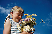 Girl with flowers wearing smocked dress, UK 1967