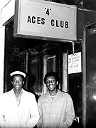 Two dapper looking chirpy chaps outside the 4 Aces Club, Dalston, London, 1977