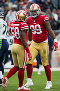 San Francisco 49ers defensive end Elvis Dumervil (58) and San Francisco 49ers defensive tackle DeForest Buckner (99) celebrate a tackle on Seattle Seahawks quarterback Russell Wilson (3) at Levi's Stadium in Santa Clara, Calif., on November 26, 2017. (Stan Olszewski/Special to S.F. Examiner)