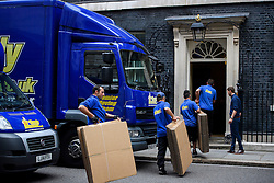 © Licensed to London News Pictures. 16/07/2016. London, UK. Boxes being taken in to number 10 Downing Street. Removal men begin to take items from numbers 10 and 11 at Downing Street at the end of the week that saw Prime Minister David Cameron leave and Theresa May arrive. Photo credit: Ben Cawthra/LNP