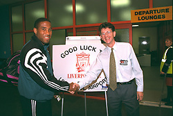 LIVERPOOL, ENGLAND - Monday, September 11, 1995: Liverpool's captain John Barnes and Liverpool Airport manager Robin Tudor before the Liverpool FC squad travel to Russia ahead of the UEFA Cup 1st Round 1st Leg match against FC Alania Spartak Vladikavkaz. (Photo by David Rawcliffe/Propaganda)