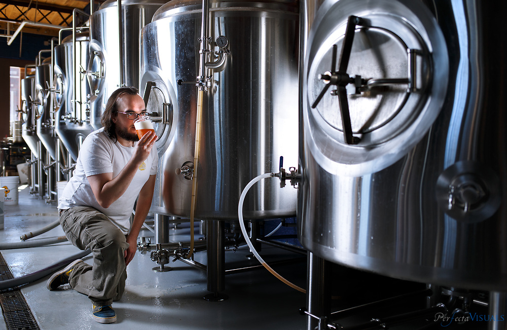 Calder Preyer at Preyer Brewing, Tuesday, October 20, 2015, in Greensboro, N.C. <br /> <br /> JERRY WOLFORD and SCOTT MUTHERSBAUGH / Perfecta Visuals<br /> <br /> Calder Preyer: &ldquo;I thought to myself &ndash; I love drinking beer; I should make it.&rdquo;<br /> <br /> Bio:&nbsp;Calder spent the last 10 years brewing beer at home and going to Chicago&rsquo;s Siebel Institute for brewing beer.<br /> &nbsp;<br /> Today, he is the brewmaster of Preyer Brewing, a local brewery he owns with his brothers, wife and parents. &ldquo;It&rsquo;s part art, it&rsquo;s part science,&rdquo; says Calder. Brewing beer is finding the perfect balance between chemistry, biology, recipe formulation and technique.<br /> &nbsp;