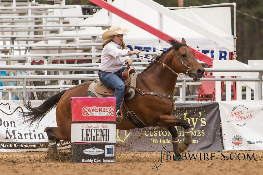 Kate Spaur makes her barrel racing run during slack at the Elizabeth Stampede on Sunday, June 3, 2018.