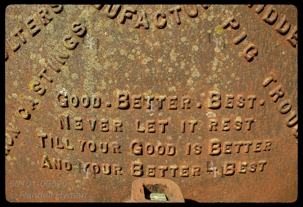 Rusty, old iron water tank bears do-your-best motto that captures Australian spirit; Coolamon, NSW Australia