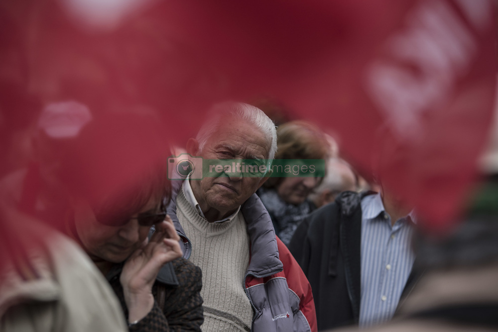 March 27, 2019 - Athens, Greece - Protesters attend speeches by pensioners' unionists as they prepare to march to the prime minister's office at Maximos Mansion. Pensioners' unions took to the streets to protest over pension cuts and fiscal policies and demand return of their slashed pensions, as their income has been shrinking since Greece entered the bailout deals in 2010. (Credit Image: © Nikolas Georgiou/ZUMA Wire)