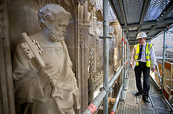 © Licensed to London News Pictures. 07/02/2018. WINCHESTER, UK. Project manager Greg Hamilton overlooks the Great Screen at Winchester Cathedral, Hampshire, as conservators are going through a spring clean removing dirt and dust from the 540-year-old stonework using soft brushes and hand-held vacuum cleaners as part of a programme of urgent repairs to the Cathedral's presbytery which has been carried out over the last three years. According to Cathedral records, this will be the first time that the Great Screen has been cleaned since the 1890s. Photo credit: ISABEL INFANTES/LNP