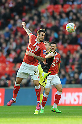 Bristol City's Marlon Pack challenges for the ariel ball with Walsall's Anthony Forde - Photo mandatory by-line: Dougie Allward/JMP - Mobile: 07966 386802 - 22/03/2015 - SPORT - Football - London - Wembley Stadium - Bristol City v Walsall - Johnstone Paint Trophy Final