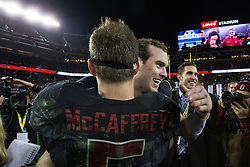 SANTA CLARA, CA - DECEMBER 05:  Running back Christian McCaffrey #5 of the Stanford Cardinal is congratulated by quarterback Kevin Hogan #8 after the Pac-12 Championship game against the USC Trojans at Levi's Stadium on December 5, 2015 in Santa Clara, California. The Stanford Cardinal defeated the USC Trojans 41-22. (Photo by Jason O. Watson/Getty Images) *** Local Caption *** Christian McCaffrey; Kevin Hogan