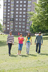 Group of friends walking in the park together