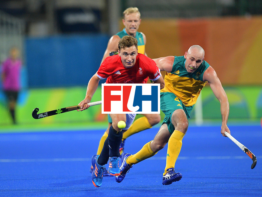 Britain's Harry Martin (L) and Australia's Glenn Turner chase the ball during the men's field hockey Britain vs Australia match of the Rio 2016 Olympics Games at the Olympic Hockey Centre in Rio de Janeiro on August, 10 2016. / AFP / Carl DE SOUZA        (Photo credit should read CARL DE SOUZA/AFP/Getty Images)