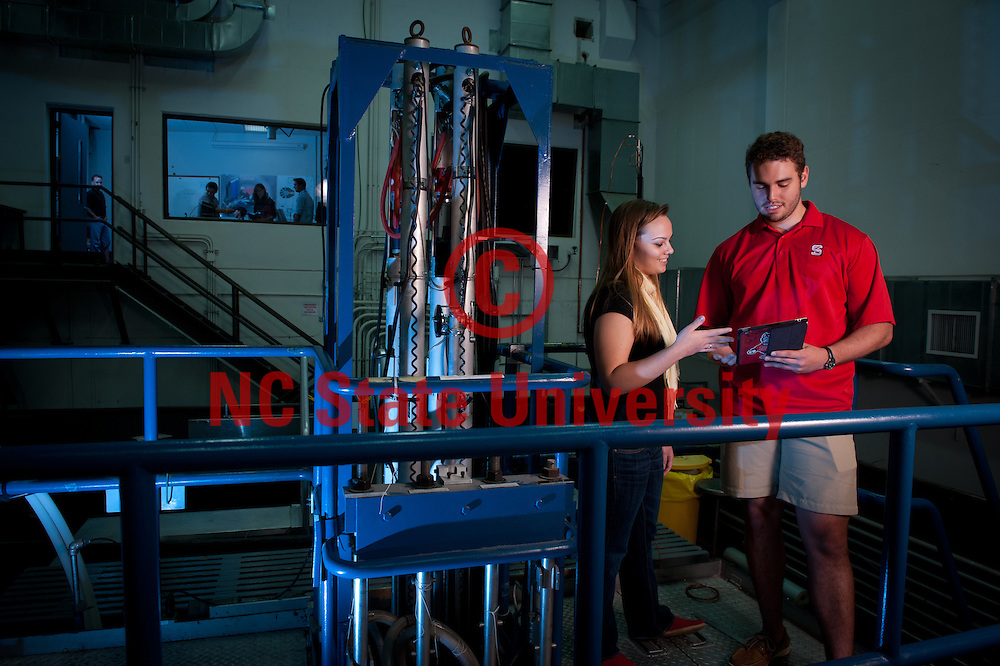 Nuclear engineering students work in the Nuclear reactor in Burlington Labs. Photo by Marc Hall