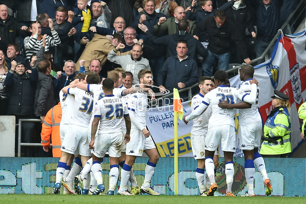 Leeds United celebrate Stuart Dallas (15) of Leeds United scoring goal to go 2 all  during the Sky Bet Championship match between Hull City and Leeds United at the KC Stadium, Kingston upon Hull, England on 23 April 2016. Photo by Ian Lyall.