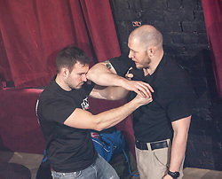 Tommy Blom demonstrates. IKMS 'In The Club' seminar with KMG Global Team Instructor and Expert Level 5, Tommy Blom, at the Buff Club in Glasgow's City Centre. Bringing Krav Maga training out with the confines of the gym into a real nightclub/bar.<br /> © Michael Schofield.