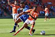 Blackpool Defender, Curtis Tilt (16) and Oldham Athletic Forward, Aaron Holloway (10) during the EFL Sky Bet League 1 match between Blackpool and Oldham Athletic at Bloomfield Road, Blackpool, England on 26 August 2017. Photo by Mark Pollitt.