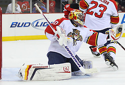 Feb 11; Newark, NJ, USA; Florida Panthers goalie Scott Clemmensen (30) makes a glove save during the second period at the Prudential Center.