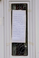 © Licensed to London News Pictures. 22/06/2011. Wickford, Essex. A note left on the front door of The home of British Teenager Ryan Cleary on South Beech Avenue, Wickford, Essex, UK. Ryan Cleary was arrested in a joint FBI and Scotland Yard operation, under suspicion of being a mastermind behind notorious international computer hacking group LulzSec. The 19-yer-old was arrested just days after the group claimed it brought down the US Central Intelligence Agency website. Photo credit should read: Ben Cawthra/LNP