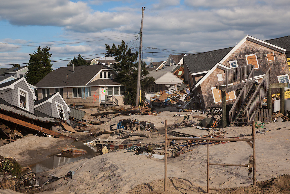 Brick Beach, New Jersey, November 3, 2012, <br />  The Jersey shore took the brunt of Hurricane Sandy. Beach, New Jersay, November 3, 2012,  A  damaged house and a ruined road remain on the beach after Hurricane Sandy  produced a surge that flooded the entire barrier island. The Jersey shore took the brunt of Hurricane Sandy.