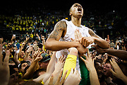 Oregon guard Joseph Young (3) lets out a roar after winning against the Utah Utes. The Oregon Ducks play the Utah Utes at Matthew Knight Arena in Eugene, Oregon on February 22, 2015. (Ryan Kang/Emerald)
