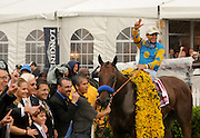 For the second year in a row, jockey Victor Espinoza celebrates winning the second leg of the Triple Crown at the 140th Preakness Stakes, Saturday, May 16, 2015, at Pimlico Race Course in Baltimore, Md.  American Pharoah will be a contender for the Triple Crown at Belmont Park on June 6.  Longines, the Swiss watch manufacturer known for its elegant timepieces, is the Official Watch and Timekeeper of the 140th annual Preakness Stakes and the Triple Crown. (Photo by Diane Bondareff/Invision for Longines/AP Images)