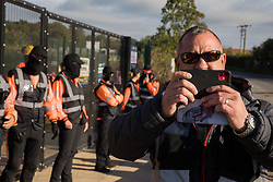 A security guard working for HS2 films a press photographer covering a protest by environmental activists from HS2 Rebellion outside a gate providing access to a site for the HS2 high-speed rail link on 12 September 2020 in Harefield, United Kingdom. Anti-HS2 activists continue to try to prevent or delay works on the controversial £106bn HS2 high-speed rail link in the Colne Valley where thousands of trees have already been felled.