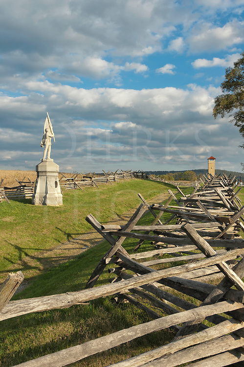 Sunken Road and Bloody Lane fence line and memorial statue, Observation Tower in distance, Antietam National Military Park, Sharpsburg, MD, USA.