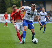 Coventry City Midfielder, Ryan Kent and Bury Defender Chris Hussey tussle for the bal during the Sky Bet League 1 match between Bury and Coventry City at Gigg Lane, Bury, England on 26 September 2015. Photo by Mark Pollitt.