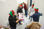 Cisco Systems, Inc., Global Procurement Services department sorts donated toys at The Family Giving Tree in Milpitas, California, on December 18, 2014. (Stan Olszewski/SOSKIphoto)