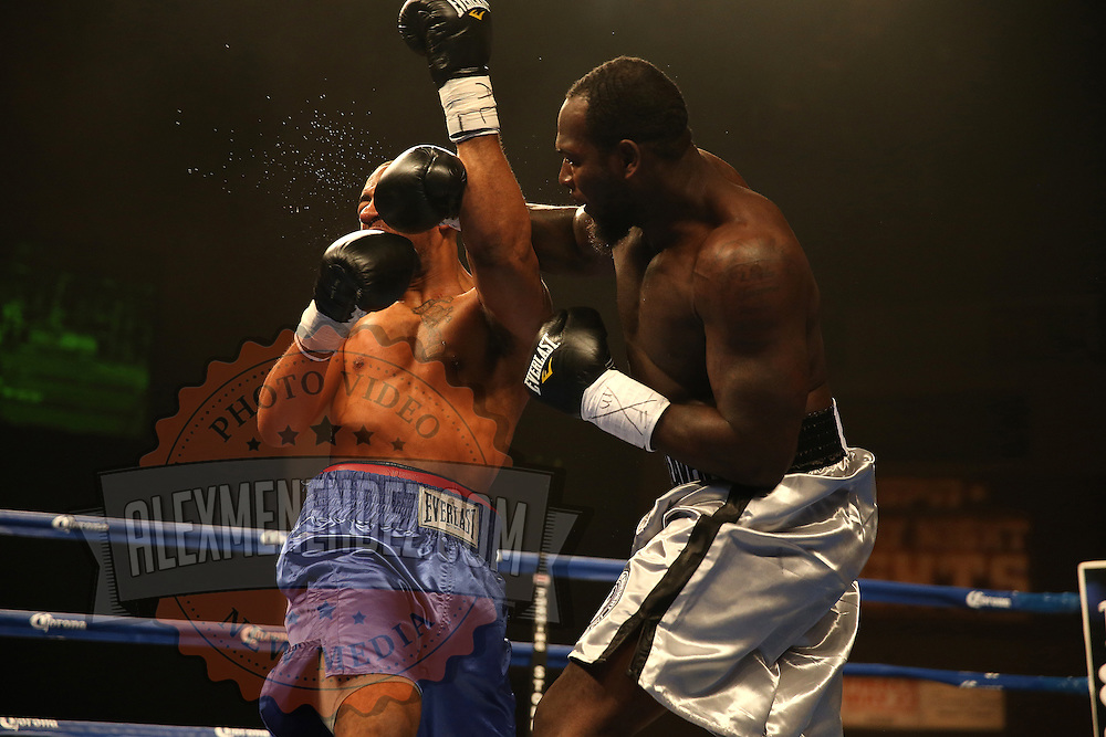 """Nat Heaven (silver shorts) wins against Donovan Dennis by TKO during  the ESPN """"Boxcino"""" boxing tournament at Turning Stone Resort Casino on Friday, April 18, 2014 in Verona, New York.  (AP Photo/Alex Menendez)"""