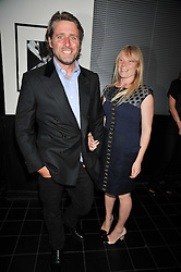 LUELLA BARTLEY and her husband DAVID SIMS  at a dinner hosted by Alexandra Shulman editor of British Vogue in association with Net-A-Porter.com to celebrate 25 years of London Fashion Week and Nick Knight held at Le Caprice, Arlington Street, London on 21st September 2009.