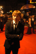 Rupert Grint. arrive at the 2006 BAFTA Awards at the Leicester Square Odeon Cinema in London. 19 February 2006.  -DO NOT ARCHIVE-© Copyright Photograph by Dafydd Jones 66 Stockwell Park Rd. London SW9 0DA Tel 020 7733 0108 www.dafjones.com