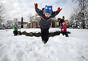 Johnny Connell, 5, takes a dive into the snow while his twin sisters Christine and Sammy, 3, and mother Megan Connell play in the yard across from their home on Winthrop Road in Clintonville on March 6, 2013. Megan, a teacher in the Worthington schools, and Johnny, a kindergartener at Immaculate Conception, had school cancelled due to the snow. Johnny insured school would be cancelled by putting ice cubes in the toilet the night before. The winter storm, which started Tuesday evening, dropped five inches of snow on Columbus according to the National Weather Service. (Adam Cairns / The Columbus Dispatch)