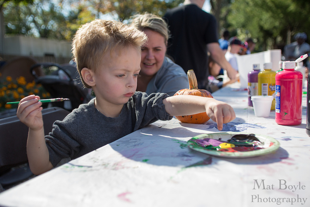 Andrew Gillespie, 2 of Gloucester Township, points to his color choice for painting his pumpkin as his mother Kylie watches during the Blackwood Pumpkin Festival on Sunday October 14, 2012. (photo / Mat Boyle)