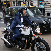 Mark Herrman from Molton Brown photographed outside the  hotel The Trafalgar St James i London for the Danish magazine Dossier. Mark Herrman rides his Triumph motor bike and wears exclusively Hugo Boss, provided for by the magazine and Hugo Boss.