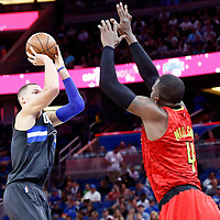25 February 2017: Orlando Magic forward Aaron Gordon (00) takes a jump shot Atlanta Hawks forward Paul Millsap (4) during the Orlando Magic 105-86 victory over the Atlanta Hawks, at the Amway Center, Orlando, Florida, USA.