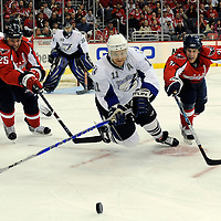 27 March 2009:  Tampa Bay Lightning center Jeff Halpern (11) falls to the ice going for a loose puck against Washington Capitals center Brooks Laich (21) and right wing Viktor Kozlov (25) in the 1st period at the Verizon Center in Washington, D.C.  The Capitals defeated the Lightning 5-3.
