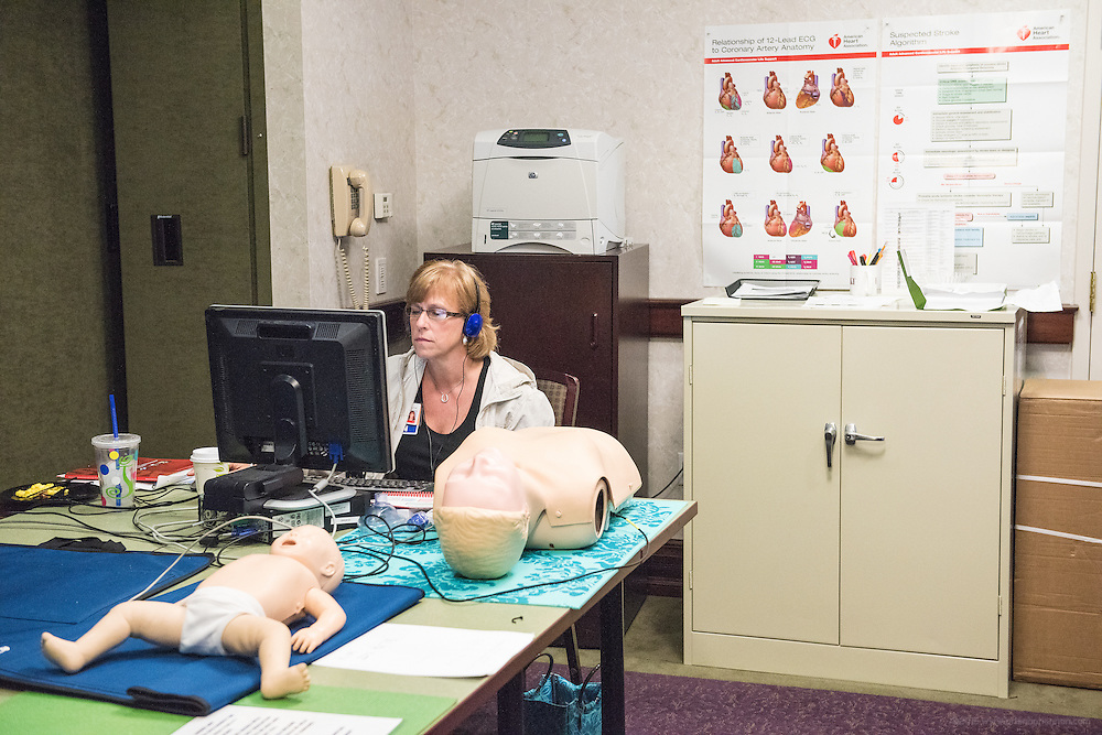 Registered Nurse Jami Chafin studies training materials in the Heart Code Room Thursday, May 21, 2015 at Baptist Health in Lexington, Ky. (Photo by Brian Bohannon/Videobred for Baptist Health)