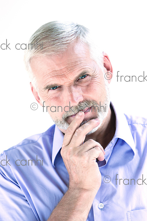 caucasian senior man portrait pensive isolated studio on white background