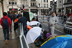 © Licensed to London News Pictures. 24/09/2015. London, UK. Customers camp out in a street next to the Apple Store in Regent Street. The iPhone 6s goes on sale at 8 am in the UK tomorrow. Photo credit: Peter Macdiarmid/LNP