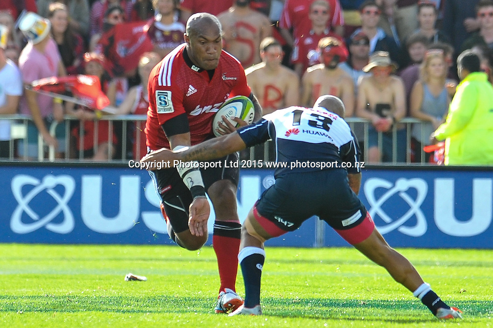 Nemani Nadolo of the Crusaders is tackled by Lionel Mapoe of the Lions during the Super Rugby match: Crusaders v Lions at AMI Stadium, Christchurch, New Zealand, 14 March 2015. Copyright Photo: John Davidson / www.Photosport.co.nz