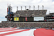 A full-field sized American flag is stretched over the field in memory of the lives lost on the 15th anniversary of the 9/11 terror attack on the United States before the Philadelphia Eagles 2016 NFL week 1 regular season football game against the Cleveland Browns on Sunday, Sept. 11, 2016 in Philadelphia. The Eagles won the game 29-10. (©Paul Anthony Spinelli)