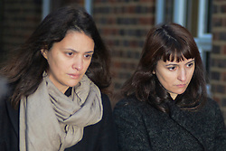 ©  London News Pictures. 28/11/2013. London, UK. Italian Sisters Elisabetta 'Lisa' (left) and Francesca (right, with handbag) Grillo, who are the former personal assistants to Charles Saatchi and Nigella  Lawson, arriving at Isleworth Crown Court in London. The pair, who face fraud charges, are accused of misappropriating funds while working for Saatchi and Lawson. Photo credit : Peter Kollanyi/LNP