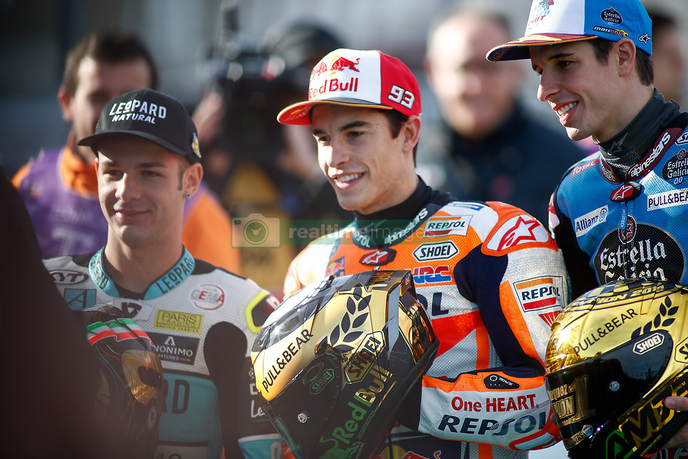 November 17, 2019, Cheste, VALENCIA, SPAIN: Lorenzo Dalla Porta, raider of Leopard Racing from Italy, Marc Marquez, rider of Repsol Honda Team from Spain, and Alex Marquez, rider of EG 0,0 Marc VDS from Spain, attends during the World Champion photo during the Valencia Grand Prix of MotoGP World Championship celebrated at Circuit Ricardo Tormo on November 16, 2019, in Cheste, Spain. (Credit Image: © AFP7 via ZUMA Wire)