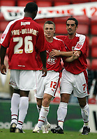 Photo: Rich Eaton.<br /> <br /> Bristol City v Crewe Alexander. Coca Cola League 1. 14/10/2006. Scott Brown centre #12 of Bristol who scored the second goal turns to celebrate with Jennison Myrie-Williams and Scott Murray #7