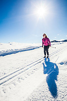 A woman cross country skiing on the trails near Sun Mountain Lodge in the Methow Valley, Washington State, USA.