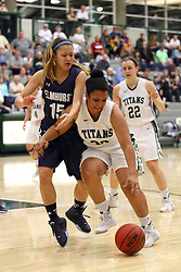 20 February 2016:  Hannah Henderson defends Gabrielle Holness during an NCAA women's basketball game between the Elmhurst Bluejays and the Illinois Wesleyan Titans in Shirk Center, Bloomington IL
