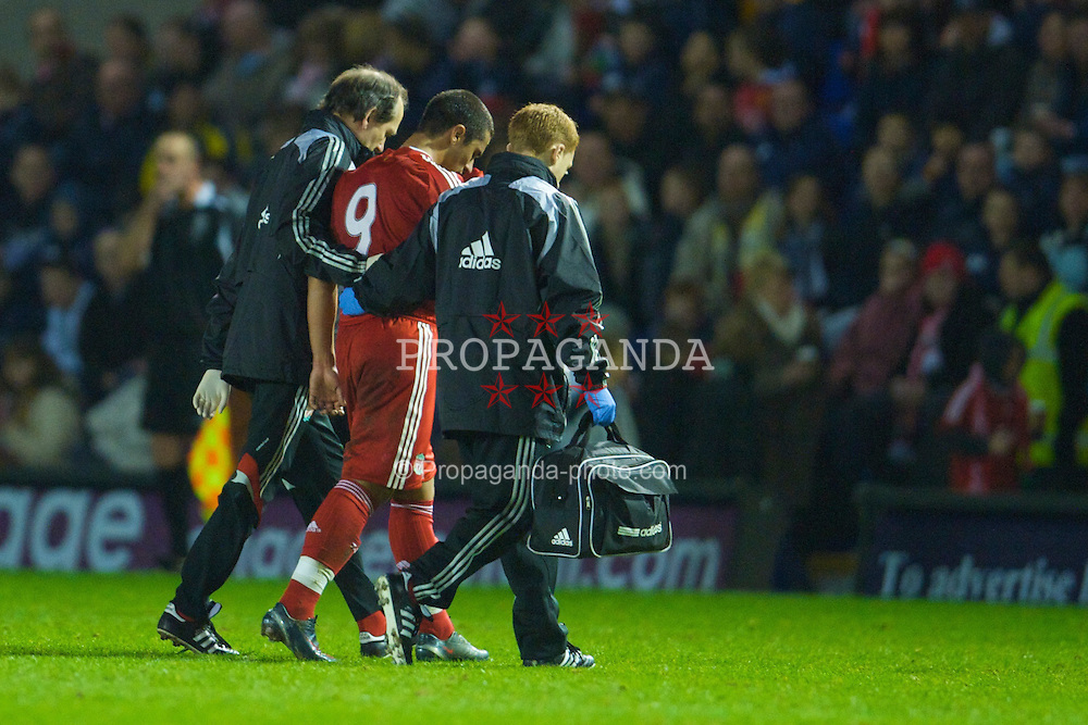 WARRINGTON, ENGLAND - Thursday, March 12, 2009: Liverpool's Vitor Flora limps off injured during the FA Premiership Reserves League (Northern Division) match against Manchester United at the Halliwell Jones Stadium. (Photo by David Rawcliffe/Propaganda)
